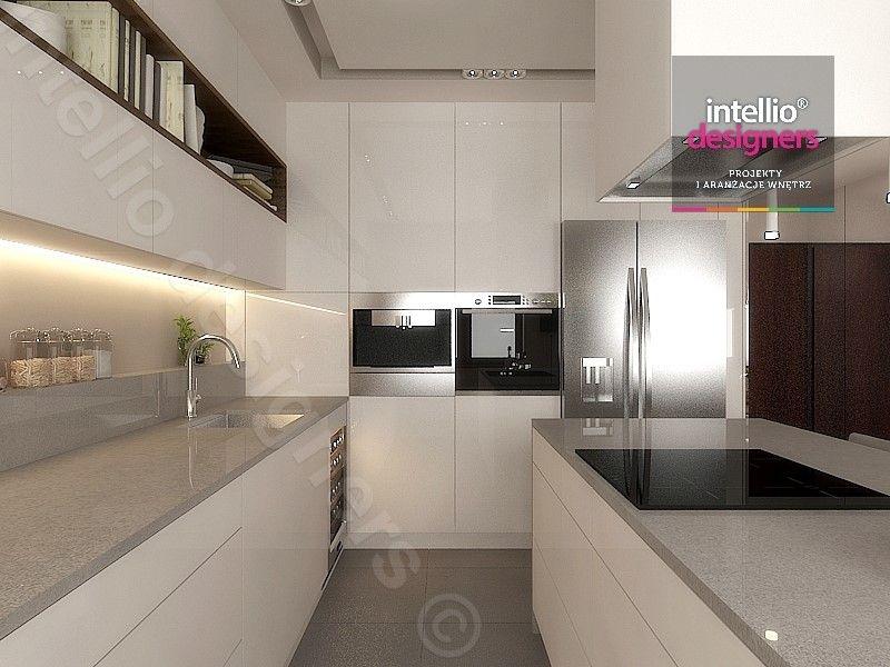 Projekt wnętrza Intellio designers – nowoczesna biała kuchnia premium